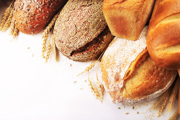 Fresh bread with wheat, sesame and sunflower seeds isolated