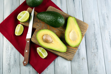 Avocado with limes and  knife