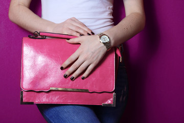 Wall Mural - fashion young trendy girl hold big pink bag near purple wall