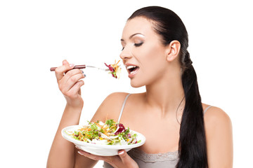 Healthy lifestyle - young woman eating salad