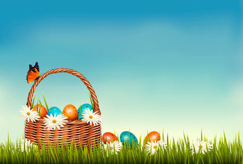 Wall Mural - Spring Easter background. Basket with Easter eggs in grass with