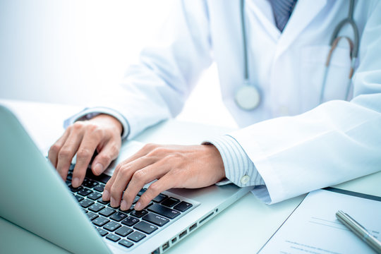 Close-up of a medical worker with laptop