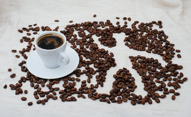 Coffee beans and symbol human in cup isolated on background