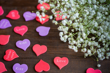 White bouquet of flowers on the table with hearts