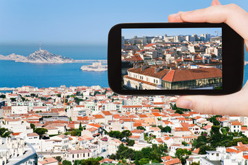 tourist taking photo of Marseille city skyline