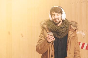 bearded man smiling listening music instagram tone