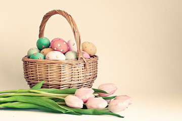 Vintage Easter Eggs in a basket and pink tulips
