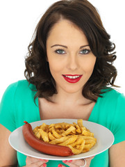 Young Woman Eating Saveloy Sausage and Chips