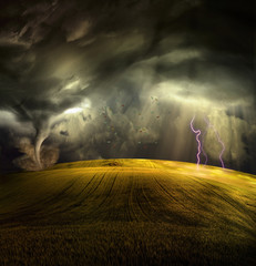 Tornado in stormy landscape