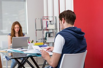 Creative team sitting at desk