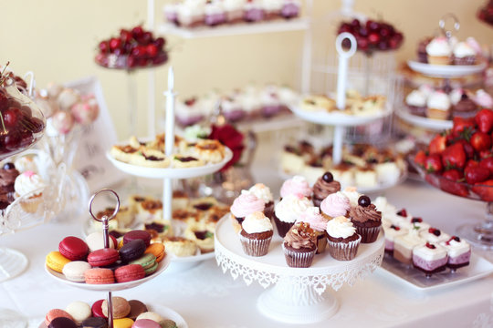 cupcakes,macaroons and sweets in a candy bar