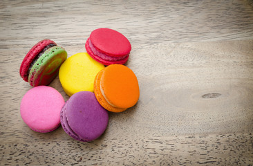 French macarons on wood background