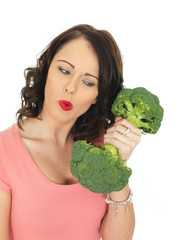 Young Woman Holding Raw Broccoli