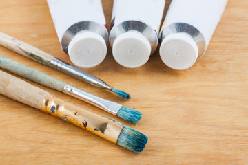 Paintbrushes with paint oil on palette.
