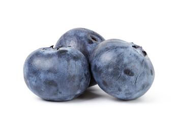 three ripe blueberries