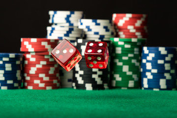 Red dices in air and poker chips