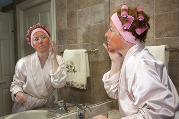 Mature Woman Performing Beauty Routine
