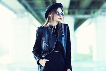 fashion model in sunglasses posing outdoor