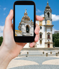 tourist taking photo of Carmo Church in Faro