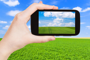 photo of green country field under blue sky