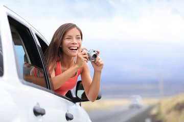 Car road trip tourist taking picture with camera