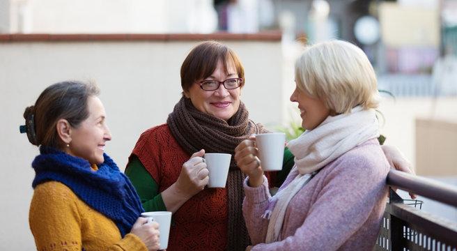 Women having tea on terrace