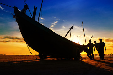 Fishermen fishing in the sea at sunrise in Namdinh, Vietnam