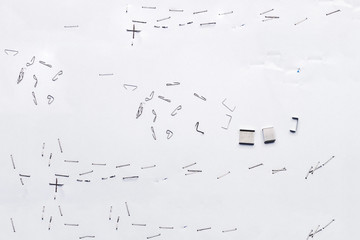 White piece of paper with staple needles.