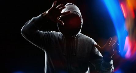 Futuristic thief hacker hacking bank password