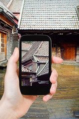 tourist taking photo of wooden houses, Bergen