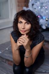 Beautiful 50-year-old woman in photo studio