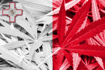 Malta Flag on cannabis background. Drug policy.