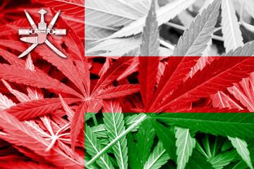 Oman Flag on cannabis background. Drug policy.