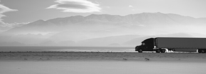 Semi Truck Travels Highway Over Salt Flats Frieght Transport