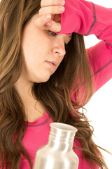 Tired woman portrait holding a stainless steel water bottle