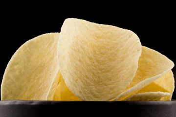 Potato chips on a black background