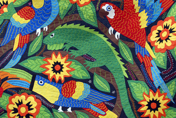 Quilted Navajo Indian art featuring toucans, iguanas, parrots