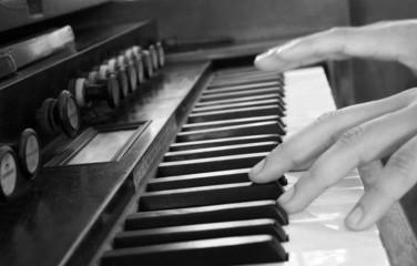 close up hand play vintage piano