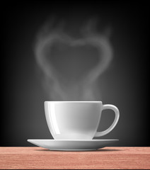 heart shape  with smoke over warm cup of coffee on wood table