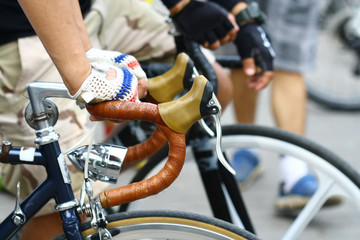 close up hand hold bicycle handle