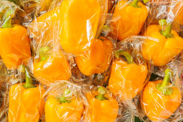 Bunch of plastic wrapped bell peppers