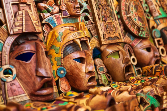 Mayan wooden handcrafted masks in a traditional Mexican market