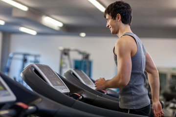 Trained man is running on a treadmill