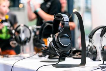 Headphones against blue background