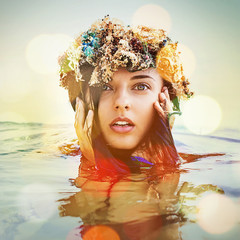 woman with wreath in water