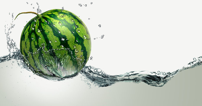 Watermelon ripe amid splashing water.