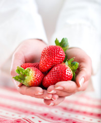 Hands Holding Strawberries