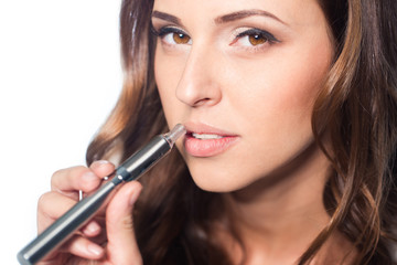 Young woman portrait with e-cigarette