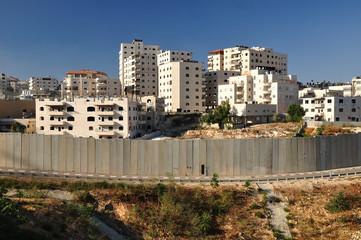 Israeli security fence near Jerusalem separating west bank.