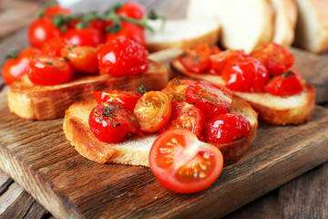 Slices of white toasted bread with canned tomatoes